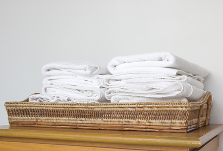 stack of white towel on basket. Stock Photo