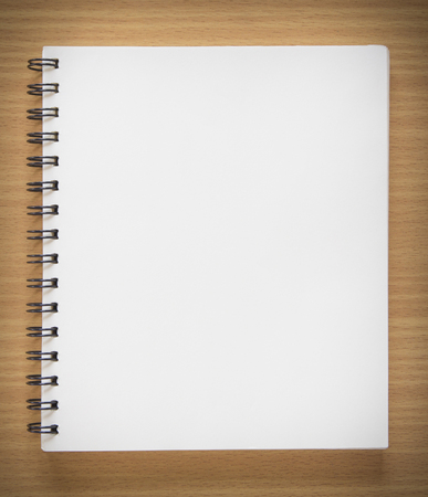 blank spiral notebook on wood background Stock Photo
