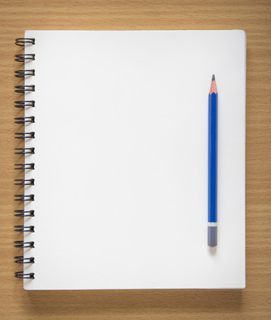 blank spiral notebook and pencil on wood background Stock Photo - 30675801