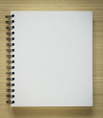 recycle notebook cover on wood background. Stock Photo