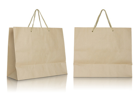 Brown paper bag on white background. Stock Photo