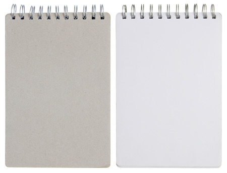 blank spiral notebook isolated on white with clipping path photo