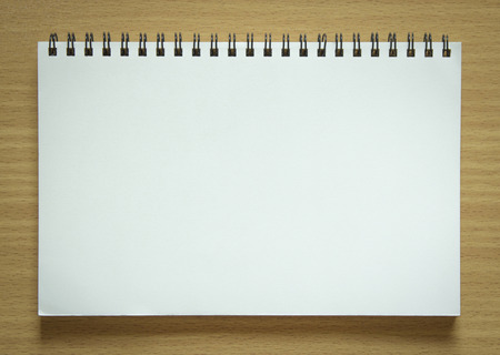 blank spiral notepad on wood background 写真素材