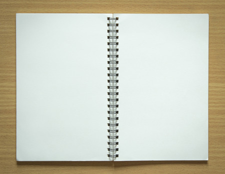 blank spiral notepad on wood background Stockfoto