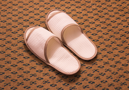 foot ware: Slippers on the floor carpet