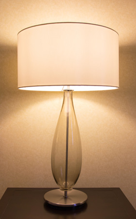 lamp shade: table lamp on desk Stock Photo
