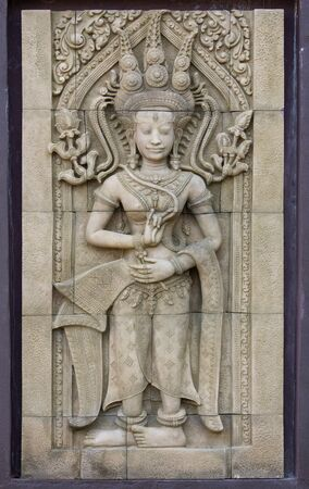 stone carving: apsara dancers statue stone carving in angkor wat, cambodia Stock Photo