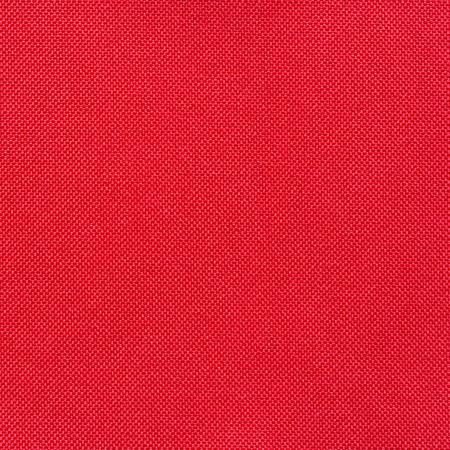 tela algodon: textura de la tela de color rojo para el fondo