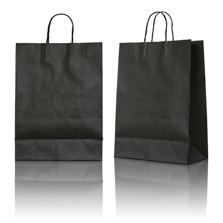 manejar: bolsa de papel negro sobre fondo blanco Foto de archivo