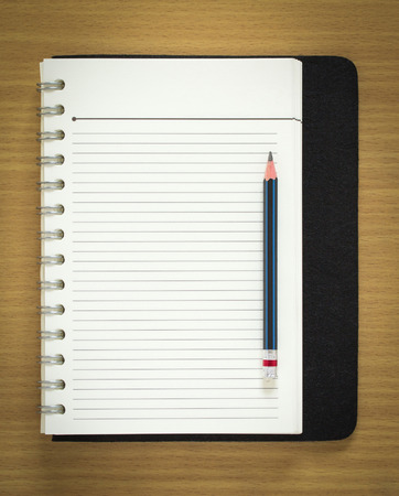 sketch book: blank spiral notepad and pencil on wood background Stock Photo