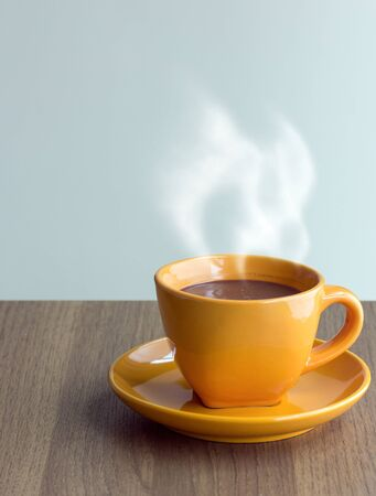 cup  coffee: steaming coffee cup on table