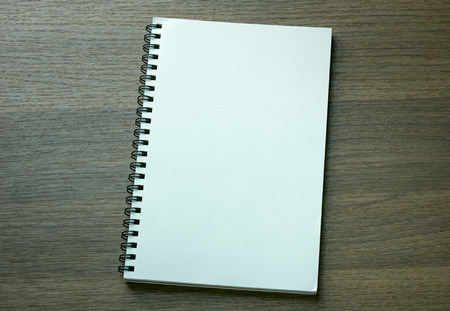 notebooks: blank spiral notebook on dark wood background