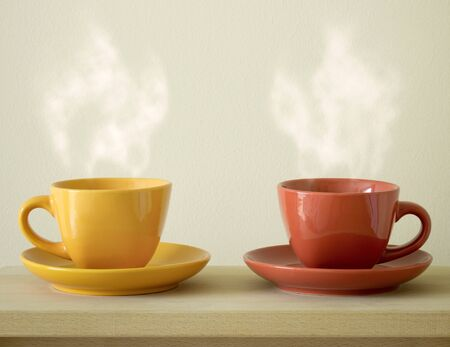 coffee mugs: steaming coffee cup on table