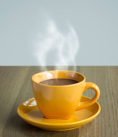 steaming coffee: steaming coffee cup on table