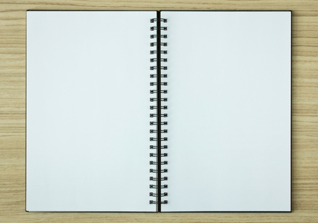 notebook: open spiral notebook on wood background