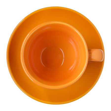 empty orange cup and saucer top view isolated on white, clipping path