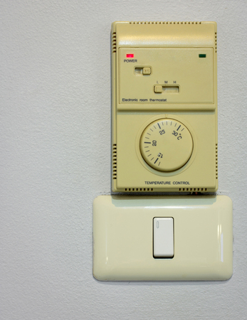dimmer: light switch and air conditioning control on wall