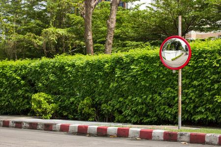 convex: traffic convex mirror at corner of street