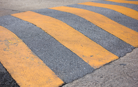 traffic safety speed bump on the road