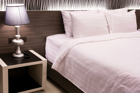 lamplight: table lamp with bedroom at hotel room Stock Photo