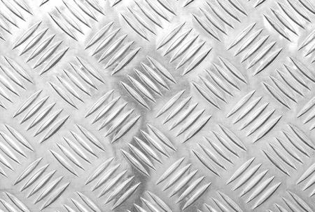 Metal floor plate background with diamond pattern