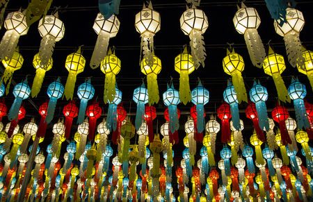 colorful hanging lanterns lighting on night sky in loy krathong festival at northern of thailand Stock Photo