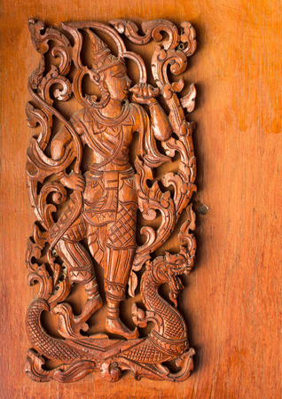 pattern of traditional thai style carved on wood background Redactioneel