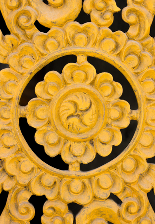 Pattern of flower carved on wood background. Traditional Thai style pattern
