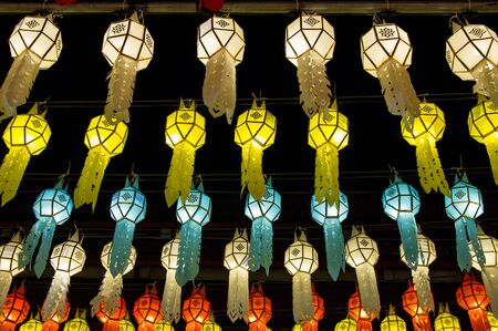 colorful hanging lanterns lighting on night sky in loy krathong festival at northern of thailand Stockfoto