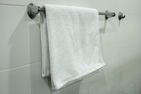 White Bath Towel Hanging on the Bathroom