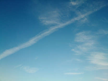 contrail: Contrail cloud on clear sky Stock Photo