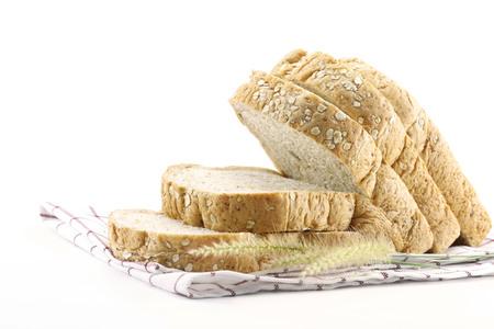 sliced bread on napkin fabric Banco de Imagens