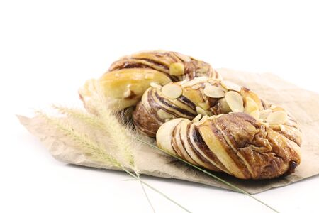 bread with almonds on paper white background Banco de Imagens