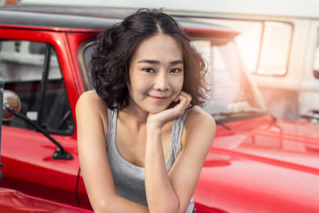 young woman relaxing in parking car outdoor background