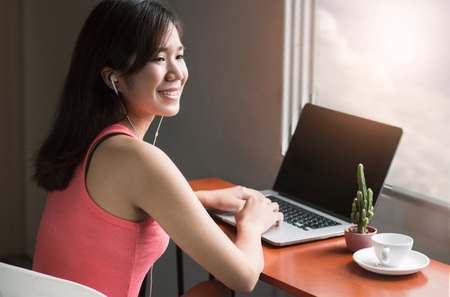 Woman relax and using laptop connecting network on wooden table