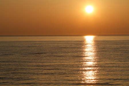 setting  sun: The setting sun of the sea