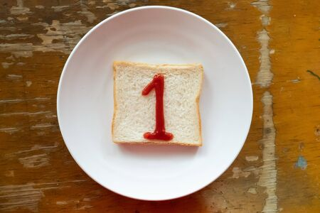 bread of breakfast is written 1 by ketchup on write plate. A to Z and Number and Special characters set.