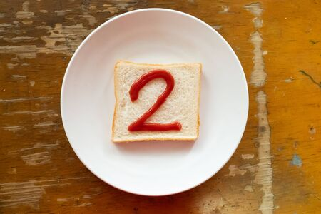 bread of breakfast is written 2 by ketchup on write plate. A to Z and Number and Special characters set.