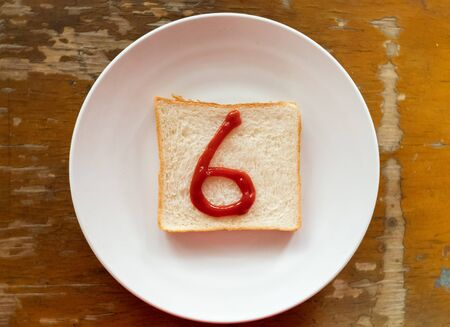 bread of breakfast is written 6 by ketchup on write plate. A to Z and Number and Special characters set.