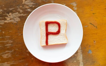 bread of breakfast is written P by ketchup on write plate. A to Z and Number and Special characters set.