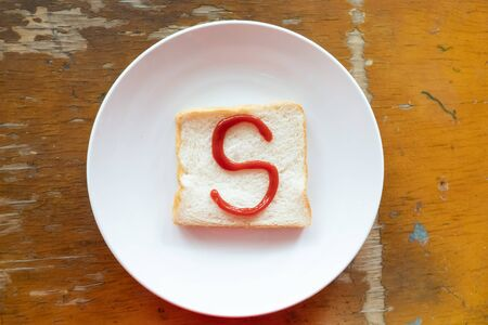 bread of breakfast is written S by ketchup on write plate. A to Z and Number and Special characters set.