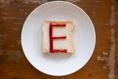 bread of breakfast is written E by ketchup on write plate. A to Z and Number and Special characters set.