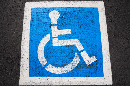 handicap sign in the parking zone photo