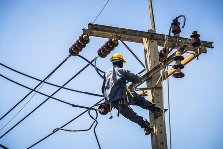 essentially: Electrician working on the electricity pole Editorial
