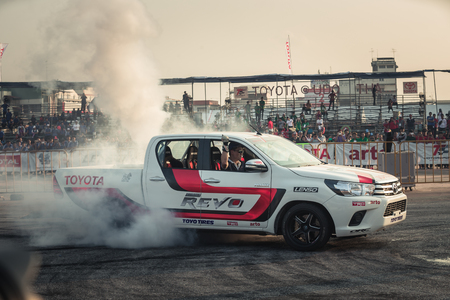 October 18, 2015:Techapol Toyingchareon the driver of  Toyota Hilux Revo perform drifting contest on the track between driver from Thailand and Japan at the event Toyota Motor Sport show at Udon Thani, Thailand with  smoke of the burnout tires
