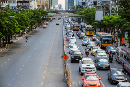 traffic jams: Heavy traffic jams cause by the construction of the BTS skytrain on the Phahonyothin Road in rush hours on the right side compare to left side that has less traffics in Bangkok, Thailand