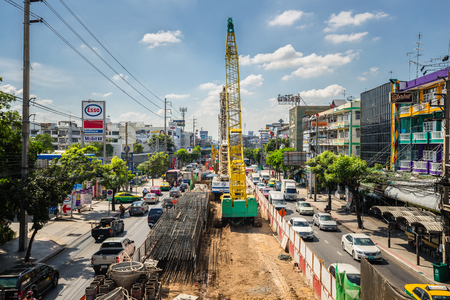 traffic jams: Heavy traffic jams cause by the construction of the BTS skytrain on the Phahonyothin Road with clear cloud blue sky in Bangkok, Thailand