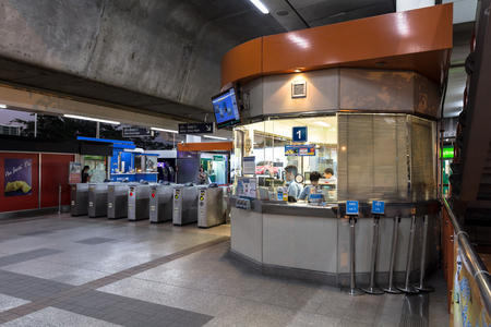 chit: Ticket office at the BTS Mo Chit station at the evening with no people buying a ticket at the office but still have the officer inside the office. Daily passengers of BTS skytrain is around 700,000.