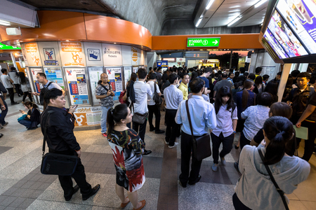 chit: Crowd of people walking out from the BTS Mo Chit station to the road in the rush hour at night with the ticket machine in the center. Daily passengers of BTS skytrain is around 700,000