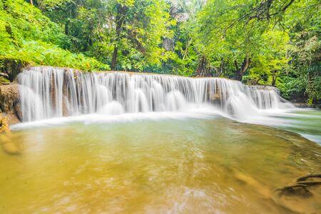 Huai Mae Khamin Waterfalls in Tropical Rainforest at Kanchanaburi Province, Thailand 스톡 콘텐츠